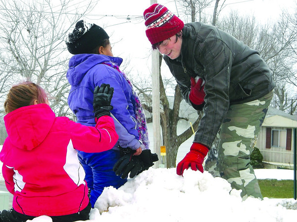 While the city of Effingham largely escaped the heavy snow that blanketed much of the region, Dieterich wasn't so fortunate. Dieterich High School sophomore Steven Haslett is using a large pile of snow left near the school to load up on snowballs. Also pictured are Mystee Haslett, a sixth grader, left, and Jayden Wilson, a third grader.