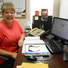 Effingham Unit 40 Transportation Director Tonna Percival sits at her desk, where she inputs data into a program that creates bus routes after years of doing them on paper. The software allows her to make routes more efficient adds to student safety.