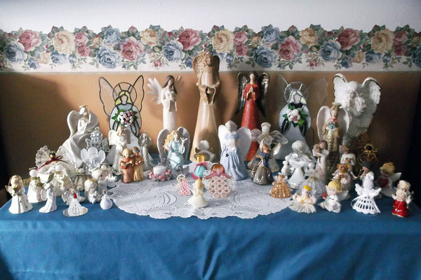 Some of the more than 100 angels are displayed at Carol Martin's home in Effingham.