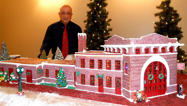 Dr. Ruben Boyajian stands near an exact gingerbread model of the B&O Depot at that location in Flora recently. The completely edible model is 58 inches long, 38 inches wide and 20 inches tall.