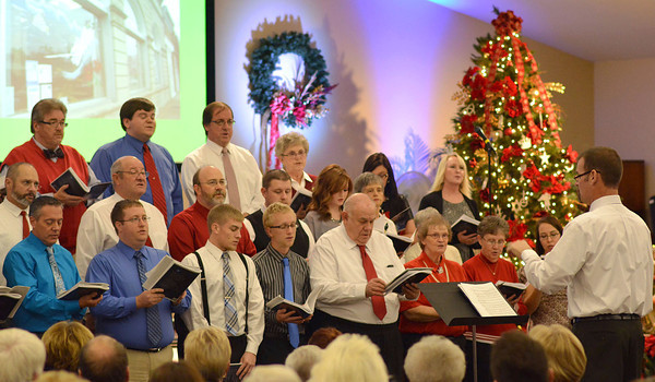 Director Kirby Davis directs performers at the Neoga Cantata at Grace United Methodist Church recently. Neoga churches joined together for the performance.