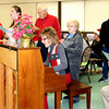 Dr. Nancy Caldwell, music professor at Lake Land College, and others sing Christmas carols at a meal sponsored by the Effingham Ministerial Alliance at the Sacred Parish Center on Christmas. More than 250 people were served.
