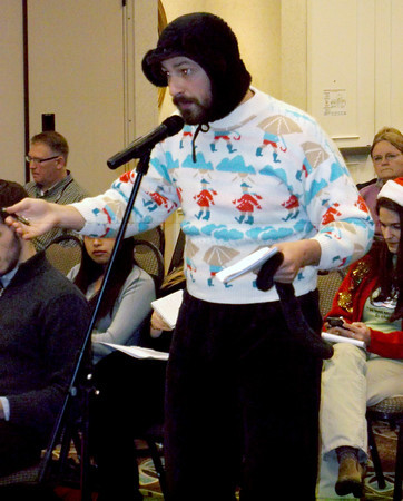 Gene Krahl of Makanda makes a point at Monday's public hearing while holding the tail of his monkey suit in his left hand. Krahl said he wore the suit to represent all species that might be affected by fracking.