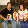 Kevin and Belinda Rueter show off pictures of their daughter Olivia. The photo Belinda is holding shows Olivia in the midst of chemotherapy last winter with a Mohawk haircut.