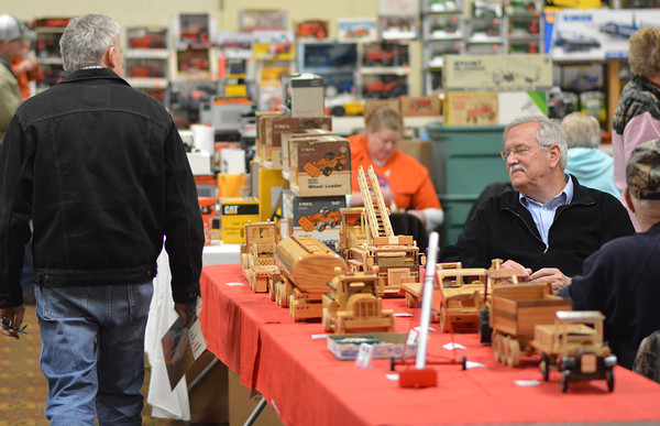 Visitors examine toys at the 21st Annual National Trail Farm Toy Show recently at the Effingham Knights of Columbus Building. More than 30 vendors sold toys at the event.