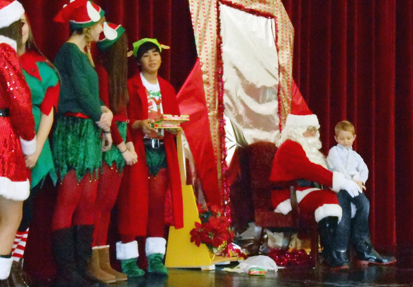 Children tell Santa what they want for Christmas at Breakfast with Santa at Effingham High School Saturday.