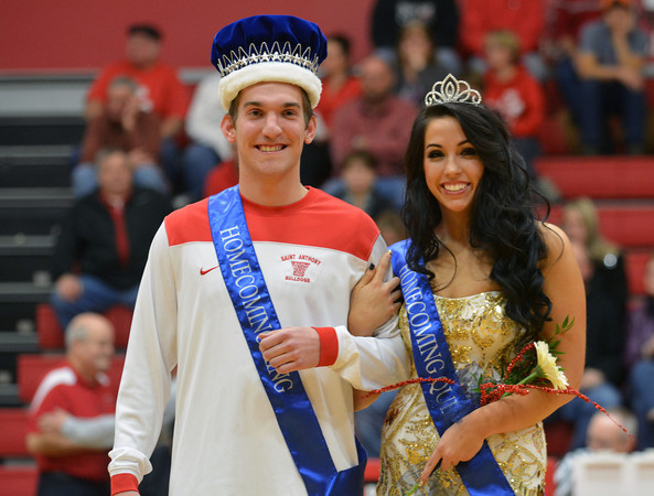 John Goeckner and Lane Steppe walk across the basketball court at St. Anthony High School after being crowned Homecoming king and queen.