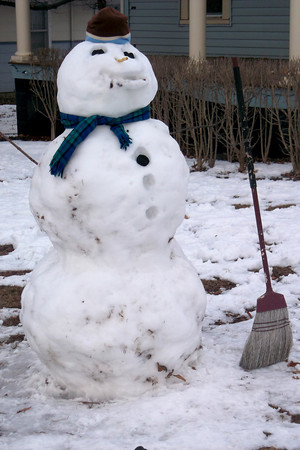 This snowman on the corner of Fourth and Clark has a broom for when he begins to melt.