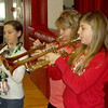 From left, Ashlin Baxter, Sydney Rich and Abby Lueken finish their school week by playing trumpets in the Effingham Junior High band during a Friday afternoon pep assembly. Several groups of students, including the state-bound EJHS girls basketball team, were recognized at the assembly.