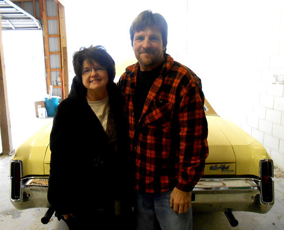 Cathy Henderson and Kevin Pocrnich stand next to the 1970 Chevrolet Monte Carlo that Pocrnich and many throughout the community worked to restore for Cathy's late husband Ron Henderson. Henderson, who was diagnosed with melanoma a year ago, died a few weeks ago just days before the car was complete.