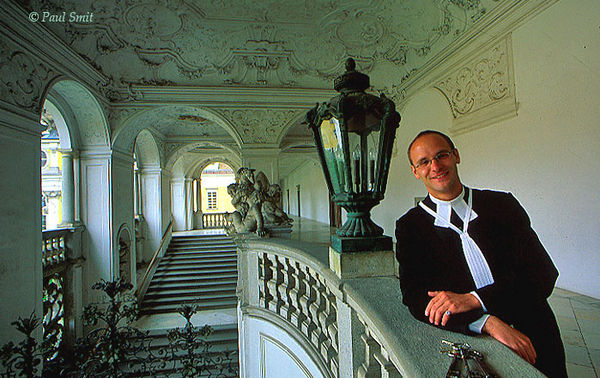 [AUSTRIA.OBER 04233] 'Augustine Chorherr in St. Florian.'  Gernot Grammer is one of the Augustine Chorherren of the St. Florian monastery. The monks do not really belong to a mendicant order; it's wealth whereever you look, like in this sumptuous staircase. During a guided tour you'll see marmor of all colours and a baroque library without any straight line. Photo Paul Smit.