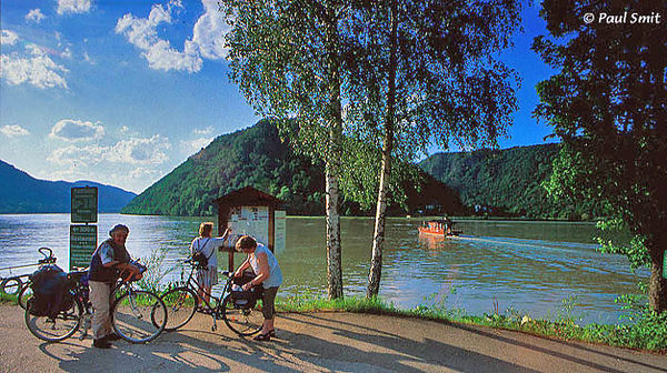 [AUSTRIA.OBER 04201] 'Cycling the Donauradweg.'  Europe's favourite cycling route, the Donauradweg, mostly follows former towpaths. In the old days about sixty heavy horses were needed to tow one boat upstream. The cobbled paths, neglected since the time of the steamboats, were asphalted in the eighties and built the frame of the cycling route from Passau to Budapest ever since. Photo Paul Smit.