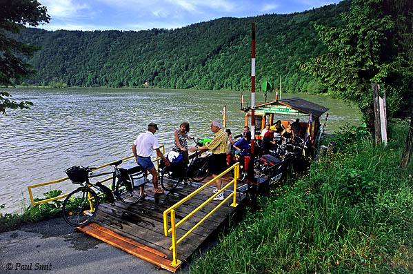 [AUSTRIA.OBER 04203] 'Cycling the Donauradweg.'  Europe's favourite cycling route, the Donauradweg, mostly follows former towpaths. In the old days about sixty heavy horses were needed to tow one boat upstream. The cobbled paths, neglected since the time of the steamboats, were asphalted in the eighties and built the frame of the cycling route from Passau to Budapest ever since. Photo Paul Smit.