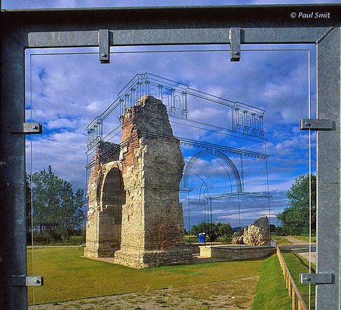 [AUSTRIA.NIEDER 03705] 'Roman Heidentor in Petronell-Carnuntum.'  For centuries the Danube was the northern border of the Roman empire. Military strongholds along the river often grew into cities. The largest became Carnuntum, where the Amber Route, connecting the Adriatic with the Baltic, crossed the Danube. It had more then 50.000 inhabitants. Nowadays it's the largest excavation of Austria. Main sight is the Heidentor, a name that is wrong in two ways. It was not a gate and not heathen, but a double triumphal arch, erected for christian emperor Constantine II. Maquettes show how it looked in those days, so does a drawing on plexiglass, through which you can see the ruins of today. Photo Paul Smit.