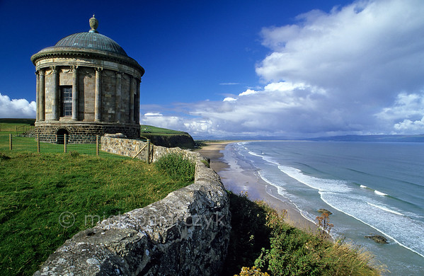 [BRITAIN.IRELANDNORTH 21.838] 'Library on the edge.'  	The Mussenden Temple at Downhill, west of Coleraine, is poised on the Atlantic coast. Built in the 18th century by an eccentric Derry bishop, it housed his library and possibly his mistress. Photo Mick Palarczyk.