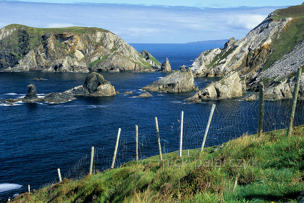 [IRELAND.DONEGAL 21.794] 'Coast at Port.'  	At Port, north of Glencolumbkille, sea-stacks and little islands give the Donegal coastline a dramatic appearance. Photo Mick Palarczyk.