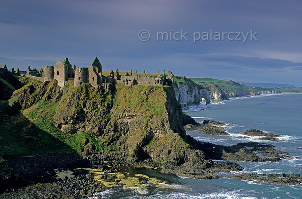 [BRITAIN.IRELANDNORTH 21.862] 'Dunluce castle.'  	The ruins of 14th century Dunluce castle balance on the edge of the Atlantic cliff coast north of Coleraine. Photo Mick Palarczyk.