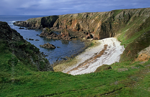 [IRELAND.DONEGAL 21.811] 'Bloody Foreland.'  	Bloody Foreland, west of Falcarragh, owes its name to the red colour of its cliffs. Photo Mick Palarczyk.