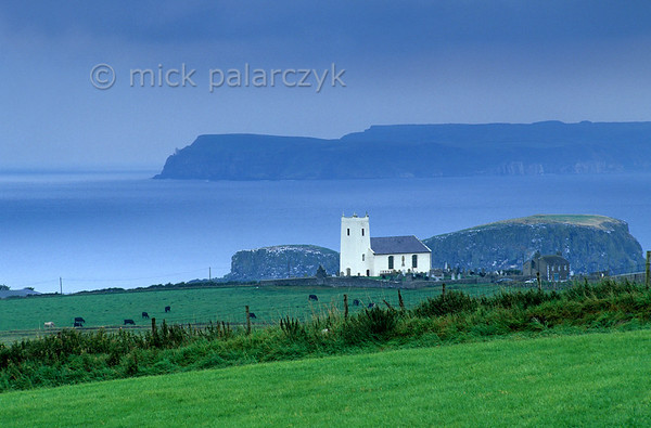 [BRITAIN.IRELANDNORTH 21.855] 'Church at Ballintoy.'  	The church of Ballintoy on the Atlantic coast. Photo Mick Palarczyk.