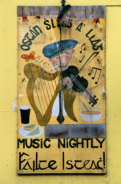 [IRELAND.DONEGAL 21.778] 'Music Nightly.'  	Irish pubs are famous for their live music. Wind battered pub sign in Carrick. Photo Mick Palarczyk.