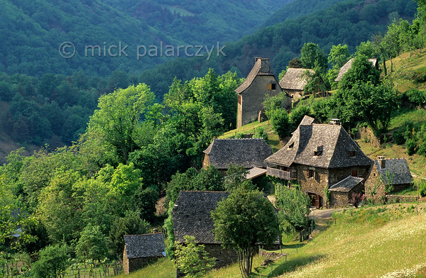 [FRANCE.AUVERGNE 28894] 'Le Murgat.'  The balconies of the farms in Le Murgat near Cassaniouze have been designed for drying chestnuts. The village is located in La Châtaigneraie, a densely forested region in the southwest corner of the Cantal which derives its name from the production of chestnuts (FR: châtaignes). Photo Mick Palarczyk.