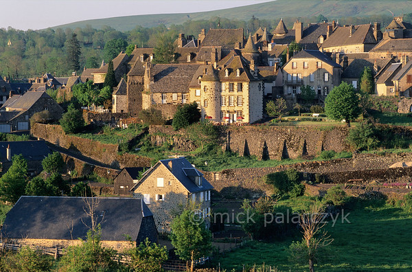 [FRANCE.AUVERGNE 28929] 'Salers.'  Salers is a beautifully preserved little town in the western Cantal. Although its walls consist of black basalt from the volcanic surroundings the use lighter pointing lends the houses and countless turrets a more friendly image. Photo Mick Palarczyk.