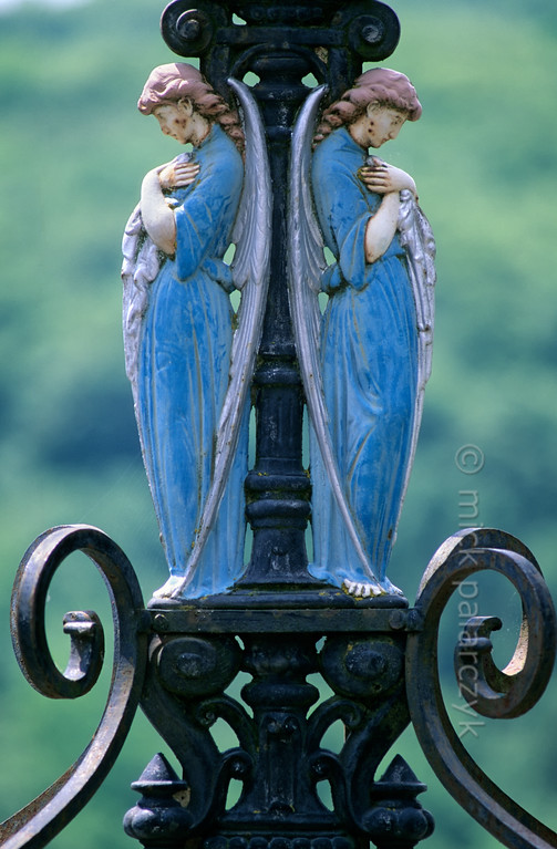 [FRANCE.AUVERGNE 28897] 'Angels in Ladinhac.'  Mourning angels adorn a road cross near Ladinhac, a village in the southwest corner of the Cantal. Photo Mick Palarczyk.