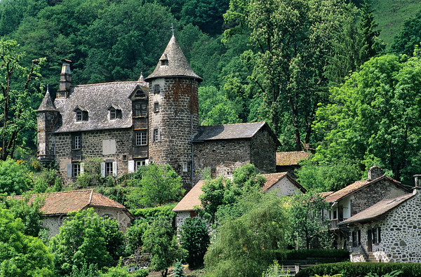 [FRANCE.AUVERGNE 28913] 'Castle of Oyez.'  The 16th century castle of Oyez in the Vallée de Mandailles, northwest of Aurillac (Cantal). It is built of basalt from the volcanic surroundings. Photo Mick Palarczyk.