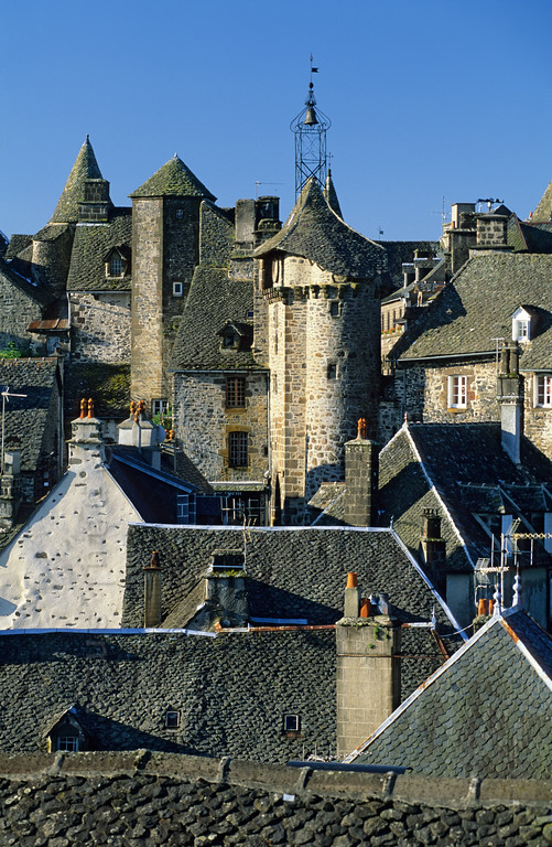 [FRANCE.AUVERGNE 28928] 'Salers.'  Salers is a beautifully preserved little town in the western Cantal. Although its walls consist of black basalt from the volcanic surroundings the use lighter pointing lends the houses and countless turrets a more friendly image. Photo Paul Smit.