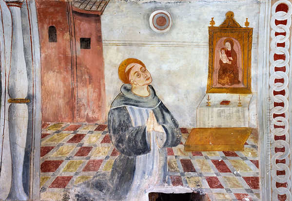 [FRANCE.ALPSSOUTH 29056] 'St. Bernard praying in front of Mary.'  The fourth of six scenes from the life of St. Bernard (923- 1008) in the St. Sebastian chapel of Roure, a village 45 km north of Nice, shows Bernard praying in front of an image of St. Mary. The fresco was executed in 1510 by Andrea de Cella, one of the so-called 'peintres primitifs niçois' (primitive painters of Nice). Photo Mick Palarczyk.