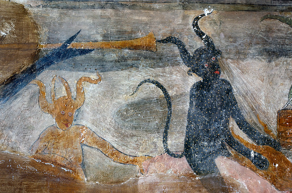 [FRANCE.ALPSSOUTH 29075] 'Devils in Roure (detail).'  	The lower left wall in the St. Sebastian chapel of Roure, a village 45 km north of Nice, showsa group of devils who are leading a priest and a naked woman to hell. The scene echoes a historic village scandal from 1427 in which Pierre Blanqui, priest of Roure, committed adultery with Delphine, the lawful wife of Jean Bovis.The fresco was executed in 1510 by Andrea de Cella, one of the so-called 'peintres primitifs niçois' (primitive painters of Nice). Photo Mick Palarczyk.
