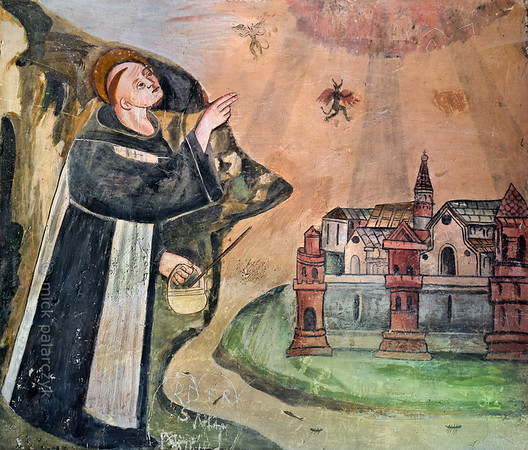[FRANCE.ALPSSOUTH 29064] 'St. Bernard drives devils from a town.'  The last of six scenes from the life of St. Bernard (923- 1008) in the St. Sebastian chapel of Roure, a village 45 km north of Nice, shows Bernard exorcising devils from a town. The fresco was executed in 1510 by Andrea de Cella, one of the so-called 'peintres primitifs niçois' (primitive painters of Nice). Photo Mick Palarczyk.