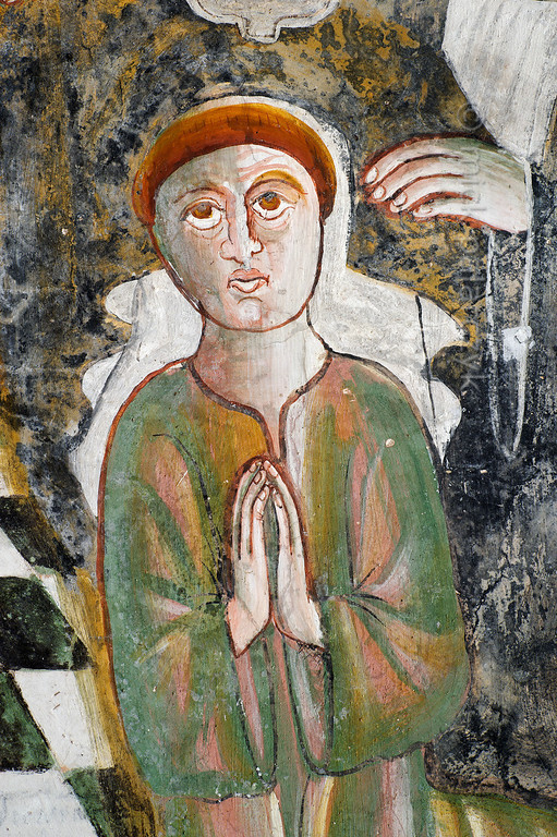 [FRANCE.ALPSSOUTH 29045] 'Kneeling Bernard of Menthon.'  The first of six scenes from the life of St. Bernard (923- 1008) in the St. Sebastian chapel of Roure, a village 45 km north of Nice, shows the saint kneeling and praying in the Augustinian chapter in Aosta. The fresco was executed in 1510 by Andrea de Cella, one of the so-called 'peintres primitifs niçois' (primitive painters of Nice). Photo Mick Palarczyk.