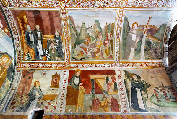 [FRANCE.ALPSSOUTH 29042] 'Right wall of St. Sebastian chapel in Roure.'  The right wall of the St. Sebastian chapel in Roure, a village 45 km north of Nice, shows six scenes from the live of St. Bernard of Menthon (923- 1008). Top left we see him entering the Augustinian chapter in Aosta. In the centre a devil is attacking pilgrims on the Alpine pass near Mont-Joux (Little St. Bernard Pass). In the scene top right Bernard enchains such a devil. Bottom left we encounter him praying before an image of Mary, and he is admonishing a sermon in the central lower scene. Finally, at bottom right, the saint is exorcising devils from a town. The frescos were executed in 1510 by Andrea de Cella, one of the so-called 'peintres primitifs niçois' (primitive painters of Nice). Photo Mick Palarczyk.