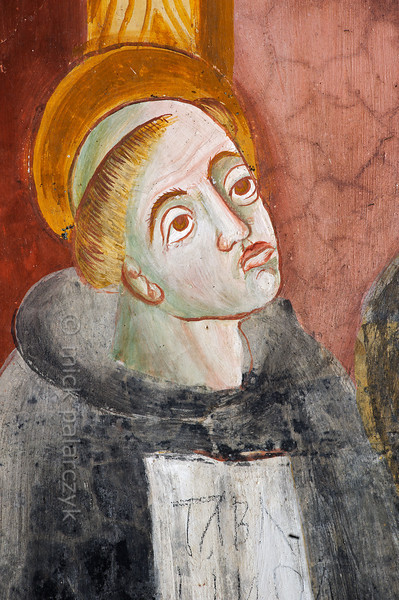 [FRANCE.ALPSSOUTH 29048] 'Augustinian monk.'  The first of six scenes from the life of St. Bernard (923- 1008) in the St. Sebastian chapel of Roure, a village 45 km north of Nice, shows a monk in the Augustinian chapter in Aosta. Detail of a scene in which Bernard is shown entering the chapter. The fresco was executed in 1510 by Andrea de Cella, one of the so-called 'peintres primitifs niçois' (primitive painters of Nice). Photo Mick Palarczyk.
