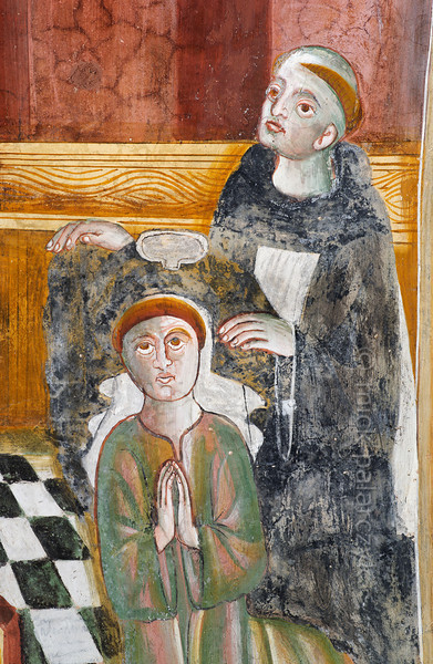 [FRANCE.ALPSSOUTH 29044] 'Bernard of Menthon enters Augustinian chapter.'  The first of six scenes from the life of St. Bernard (923- 1008) in the St. Sebastian chapel of Roure, a village 45 km north of Nice, shows the saint entering the Augustinian chapter in Aosta. Bernard is kneeling while a monk administers the laying on of hands. The fresco was executed in 1510 by Andrea de Cella, one of the so-called 'peintres primitifs niçois' (primitive painters of Nice). Photo Mick Palarczyk.