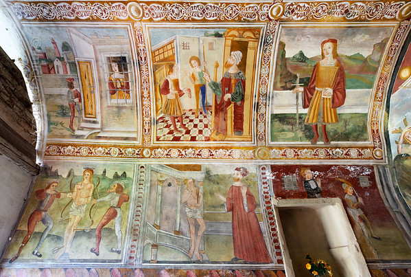 [FRANCE.ALPSSOUTH 29065] 'Left wall of St. Sebastian chapel in Roure.'  The left wall of the St. Sebastian chapel in Roure, a village 45 km north of Nice, shows six scenes from the live of St. Sebastian, a captain of the Praetorian Guard under the Roman Emperor Diocletian. Top left we see him imprisoned because of his pro-Christian attitude. In the centre he is brought before the emperor and top right we see him standing dressed as a nobleman. Below left is the well-known scene of his execution. In the centre Sebastian, nursed back to health, is condemning Diocletian for his cruelty. The final, partly destroyed scene, show the death of Sebastian. The frescos were executed in 1510 by Andrea de Cella, one of the so-called 'peintres primitifs niçois' (primitive painters of Nice). Photo Mick Palarczyk.