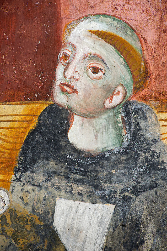[FRANCE.ALPSSOUTH 29049] 'Augustinian monk.'  	The first of six scenes from the life of St. Bernard (923- 1008) in the St. Sebastian chapel of Roure, a village 45 km north of Nice, shows a monk in the Augustinian chapter in Aosta. Detail of a scene in which Bernard is shown entering the chapter. The fresco was executed in 1510 by Andrea de Cella, one of the so-called 'peintres primitifs niçois' (primitive painters of Nice). Photo Mick Palarczyk.