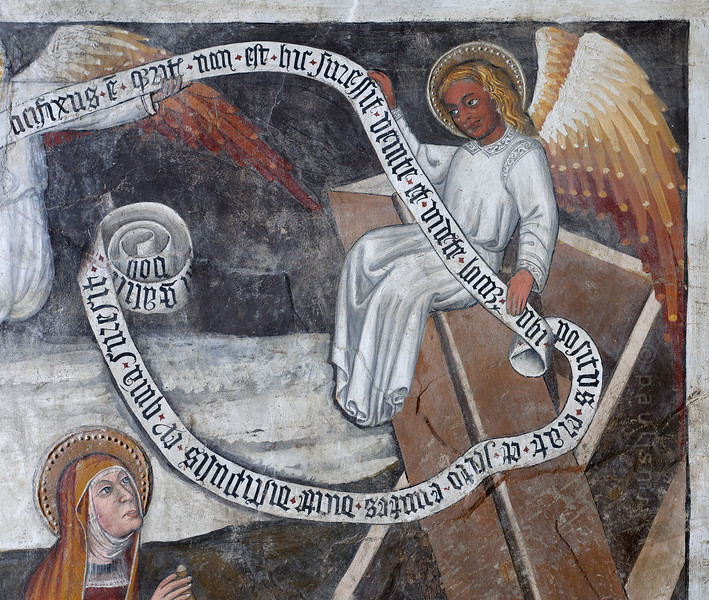 [FRANCE.ALPSNORTH 10961] 'Angel on an empty tomb.'  The interior of the Chapelle Saint Antoine in Bessans is covered with frescoes and a part of the exterior as well. Even if the religious meaning escapes you, you can enjoy the quality of the work and the details. Like this angel, sitting on the lid of Jesus' empty grave. The chapel and its frescoes date from the beginning of the 16th century. Photo Paul Smit.