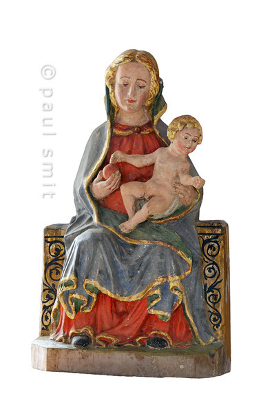 [FRANCE.ALPSNORTH 10966] 'Madonna, child and apple.'  The Chapelle Saint Antoine in Bessans is famous for its late medieval frescoes. But it houses a nice madonna with child, as well.  The apple (in fact probably a pomegranate) should remind us why we have been driven out of paradise. But it is an apple of salvation, not damnation (as the one plucked from the Tree of Knowledge). In fact, Mary offers us an apple symbolizing the redemption she has brought to the world by incarnating Christ. She thus appears as a New Testament antitype to Eve. Photo Paul Smit.