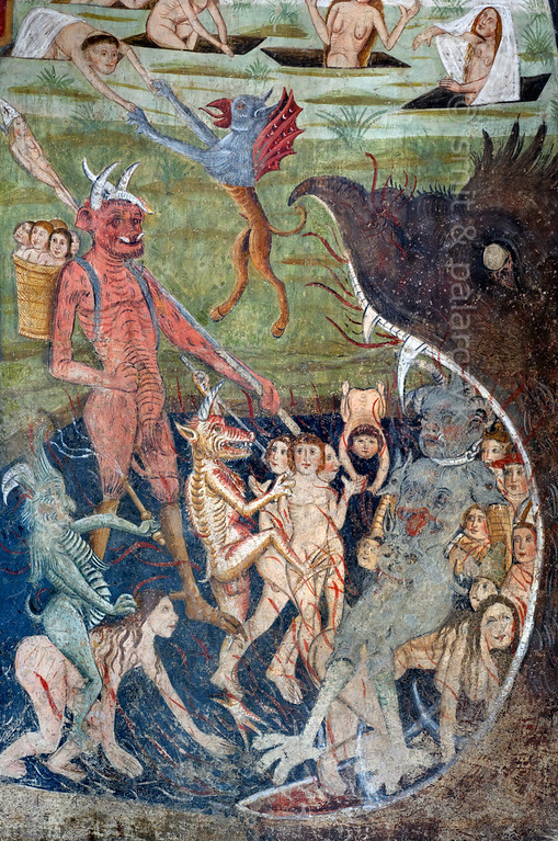 [FRANCE.ALPSSOUTH 29098] 'Leading the damned to hell.'  	The altar wall of the Chapelle des Pénitents Blancs at La Tour shows several devils leading the damned to the mouth of hell. The image is part of a Last Judgment scene that was executed in 1492 by Currand Bravesi and Guirard Nadal, two of the so-called 'peintres primitifs niçois' (primitive painters of Nice). La Tour sur Tinée is a village in the French Alps, 30 km north of Nice. Photo Mick Palarczyk & Paul Smit.