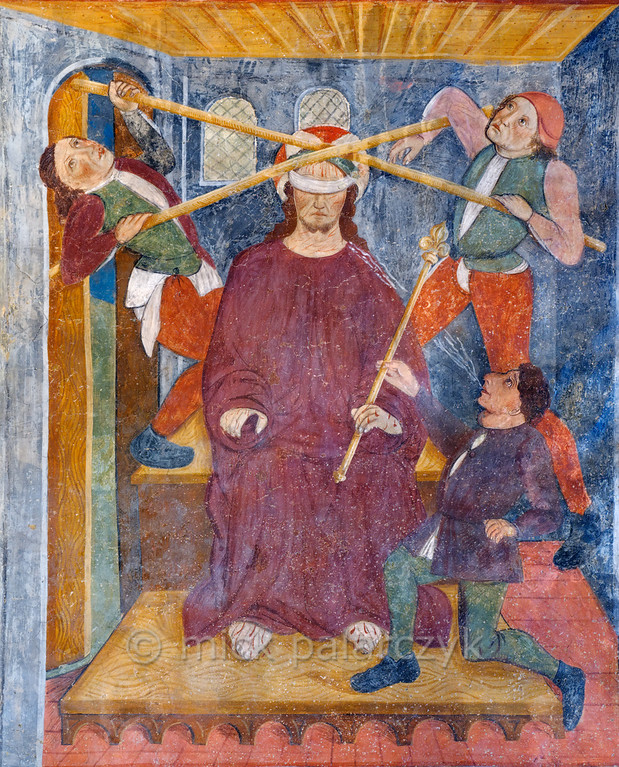 [FRANCE.ALPSSOUTH 29086] 'Derision of Christ.'  	The ninth of twenty panels depicting the Passion of Christ in the Chapelle des Pénitents Blancs at La Tour shows the derision of a blindfolded Jesus. He is spat at and two men use canes to press the crown of thorns on his head (the crown itself is not visible, though). The fresco was executed in 1492 on the chapel's right wall by Currand Bravesi and Guirard Nadal, two of the so-called 'peintres primitifs niçois' (primitive painters of Nice). La Tour sur Tinée is a village in the French Alps, 30 km north of Nice. Photo Mick Palarczyk.