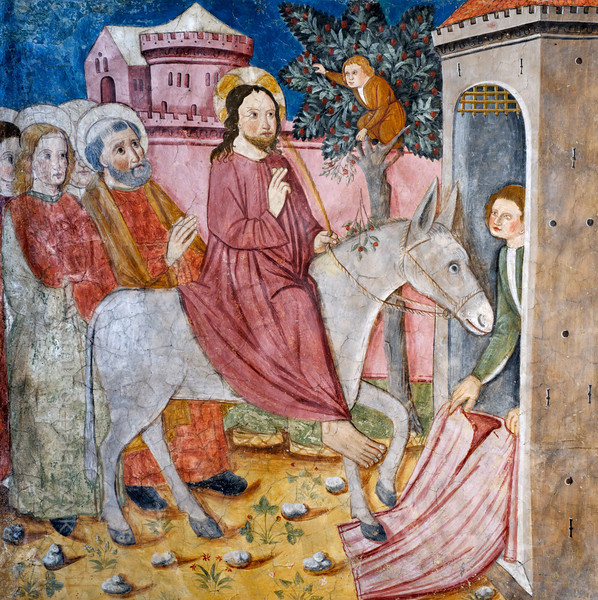 [FRANCE.ALPSSOUTH 29078] 'Arrival in Jerusalem.'  	The first of twenty panels depicting the Passion of Christ in the Chapelle des Pénitents Blancs at La Tour shows Jesus riding a donkey into Jerusalem on Palm Sunday. To honour him people spread their cloaks on the ground and also lay down branches of trees. The gospel of John specifically mentions palm fronds (hence Palm Sunday) but in northern climates substitutes like yew, willow or box were often depicted. The fresco was executed in 1492 on the chapel's left wall by Currand Bravesi and Guirard Nadal, two of the so-called 'peintres primitifs niçois' (primitive painters of Nice).  La Tour sur Tinée is a village in the French Alps, 30 km north of Nice. Photo Mick Palarczyk & Paul Smit.