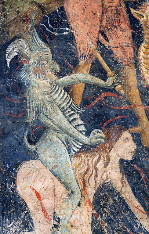 [FRANCE.ALPSSOUTH 29100] 'Leading the damned to hell.'  	The altar wall of the Chapelle des Pénitents Blancs at La Tour shows a devil riding a damned woman to the mouth of hell. The image is part of a Last Judgment scene that was executed in 1492 by Currand Bravesi and Guirard Nadal, two of the so-called 'peintres primitifs niçois' (primitive painters of Nice). La Tour sur Tinée is a village in the French Alps, 30 km north of Nice. Photo Mick Palarczyk.