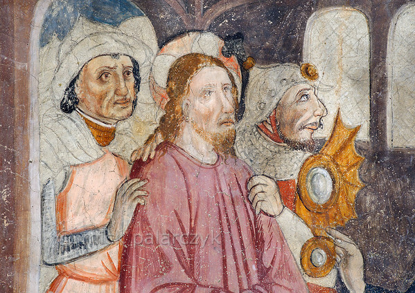 [FRANCE.ALPSSOUTH 29085] 'Jesus led by two soldiers.'  	The seventh of twenty panels depicting the Passion of Christ in the Chapelle des Pénitents Blancs at La Tour shows Jesus being led by soldiers to the high priest Caiaphas (detail). The fresco was executed in 1492 on the chapel's right wall by Currand Bravesi and Guirard Nadal, two of the so-called 'peintres primitifs niçois' (primitive painters of Nice). The painters seem to have left part of the soldiers' garments in an unfinished state. La Tour sur Tinée is a village in the French Alps, 30 km north of Nice. Photo Mick Palarczyk.