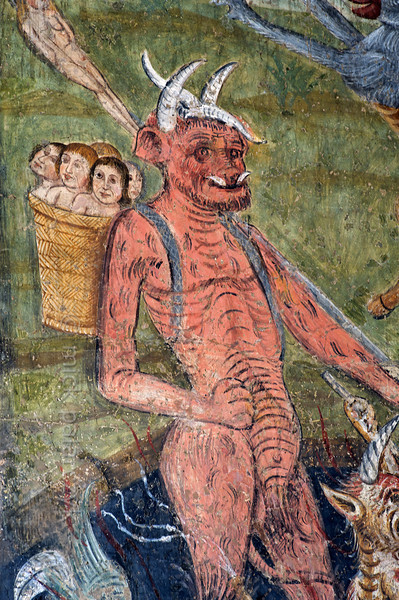 [FRANCE.ALPSSOUTH 29101] 'Carrying the damned to hell.'  The altar wall of the Chapelle des Pénitents Blancs at La Tour shows a devil carrying the damned to the mouth of hell in a basket. The image is part of a Last Judgment scene that was executed in 1492 by Currand Bravesi and Guirard Nadal, two of the so-called 'peintres primitifs niçois' (primitive painters of Nice). La Tour sur Tinée is a village in the French Alps, 30 km north of Nice. Photo Mick Palarczyk.