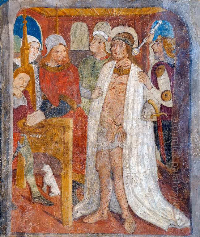 [FRANCE.ALPSSOUTH 29088] 'Jesus before Pontius Pilate.'  	The tenth of twenty panels depicting the Passion of Christ in the Chapelle des Pénitents Blancs at La Tour shows Jesus brought before Pontius Pilate. The Roman prefect washes his hands to show that he will not be responsible for the execution of Christ. The fresco was executed in 1492 on the chapel's right wall by Currand Bravesi and Guirard Nadal, two of the so-called 'peintres primitifs niçois' (primitive painters of Nice). La Tour sur Tinée is a village in the French Alps, 30 km north of Nice. Photo Mick Palarczyk.