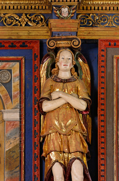 [FRANCE.ALPSNORTH 10980] 'Teenage angel.'  The Haute Maurienne is reknown for its art along the <i>Chemins du Baroque</i>, the Baroque Trail. Most of the angels seen in the local churches and chapels are putti, baby angels. But the Chapelle Saint Sébastien in Lanslevillard hosts two teenagers, of which this is one, in the role of a caryatid. Photo Paul Smit.