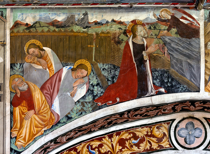 [FRANCE.ALPSNORTH 10974]<br /> 'Christ's agony at Gethsemane.'<br /> <br /> Not only do the frescoes in the Chapelle Saint Sébastien in Lanslevillard reach an astonishing high artistic level, the colours have kept their original saturation as well. This most important work of art in the Haute Maurienne has been painted at the end of the 15th century by artists from Piemonte (now in Italy but then in the same country: Savoy). Its location may seem unexpected: a small village deep in the Alps. But the chapel is situated right at the start of the pass road over the Col du Mont Cenis, in those days one of the main connections between France and Italy.<br /> <br /> The fresco shows a scene from the Gospel of Luke, where Jesus is seen praying and receiving strength from an angel on the Mount of Olives, while his discipels sleep, prior to his betrayal and arrest. Photo Paul Smit.