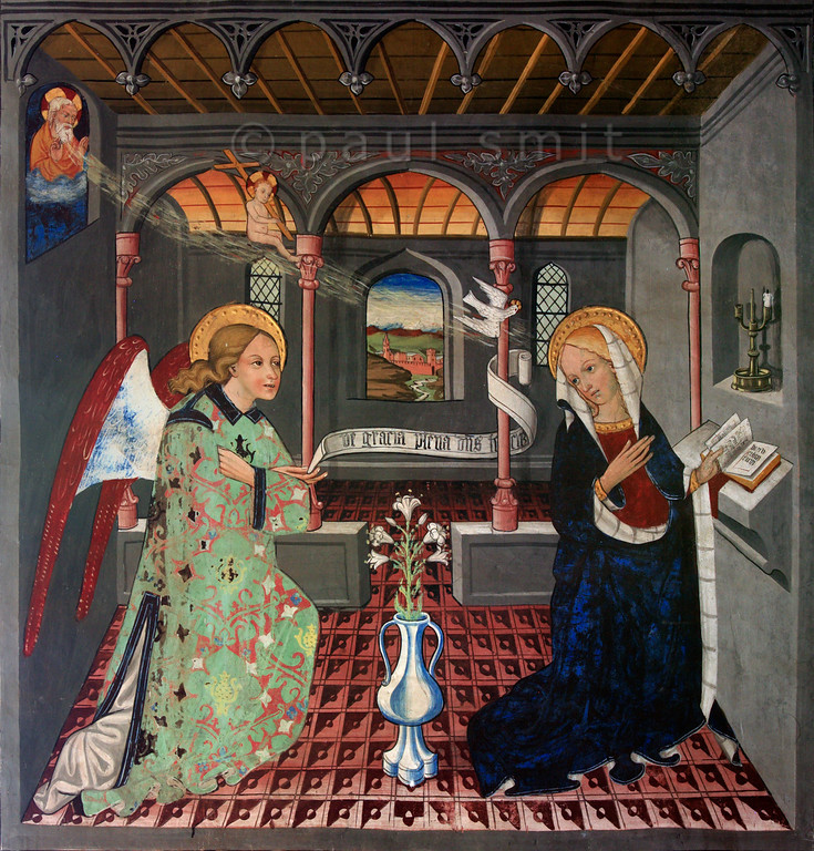 [FRANCE.ALPSNORTH 10970]<br /> 'Annunciation.'<br /> <br /> Not only do the frescoes in the Chapelle Saint Sébastien in Lanslevillard reach an astonishing high artistic level, the colours have kept their original saturation as well. This most important work of art in the Haute Maurienne has been painted at the end of the 15th century by artists from Piemonte (now in Italy but then in the same country: Savoy). Its location may seem unexpected: a small village deep in the Alps. But the chapel is situated right at the start of the pass road over the Col du Mont Cenis, in those days one of the main connections between France and Italy.<br /> <br /> Touching detail in this fresco of the Annunciation: baby Jesus. He is flying, together with the Holy Spirit, from God to Mary. Photo Paul Smit.